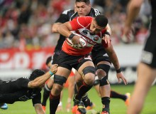 Japan carries the ball up hard against the Maori All Blacks