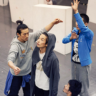The cast of PLUTO rehearsing