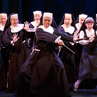 Dolores (Arrington) teaches nuns to sing(Photo © Joan Marcus)