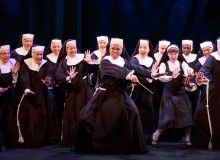 Dolores (Kerissa Arrington, center) teaches nuns to sing
