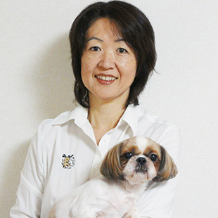 Bark Busters director Chie Kawazoe and dog