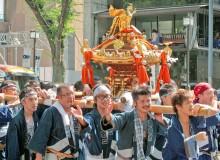 Festival participants life the mikoshi