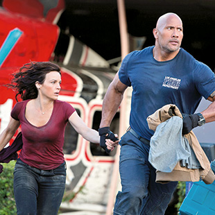Johnson (right) and Carla Gugino (left, as Ray's wife Emma) in <em>San Andreas</em>