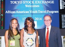 Richardson (left) with 2014 scholarship recipient Destiny Gray (center) at the Tokyo Stock Exchange