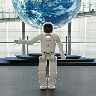 ASIMO greeting guests at the Miraikan