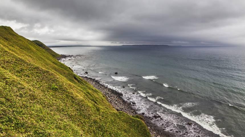 Dark Clouds Over Idyllic Islands