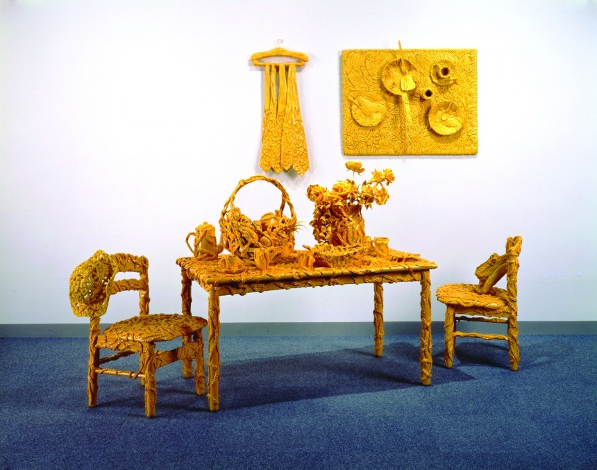 Yellow table and chairs sculpture by Yayoi Kusama