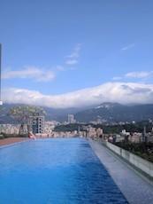 48 hours in Taipei Lindsay Nemeth pool mountain view cloud