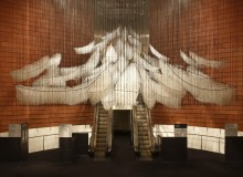"Shiota Chiharu, ""In Silence"" 2002/2019 Burnt piano, burnt chair, Alcantara black thread Installation view: Shiota Chiharu: The Soul Trembles, Mori Art Museum, Tokyo, 2019 Courtesy: Kenji Taki Gallery, Nagoya/Tokyo Photo: Sunhi Mang  Photo Courtesy: Mori Art Museum, Tokyo"